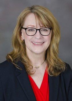 Karen E. Adams, MD, FACOG*, NCMP**